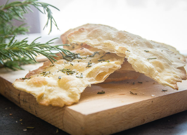 thin crispy focaccia on a board