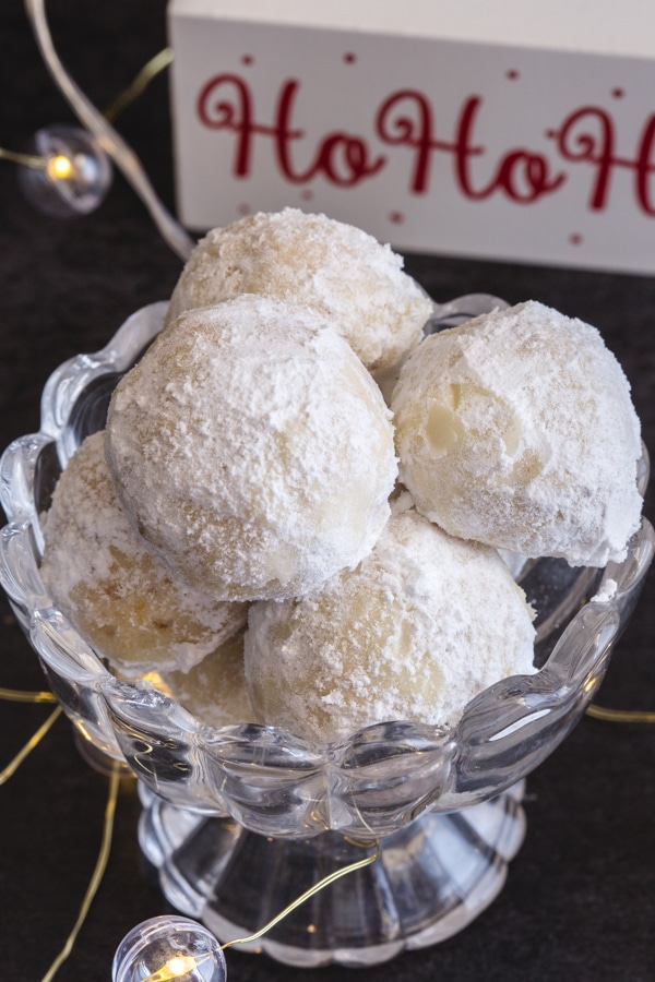 snowball cookies in a glass bowl
