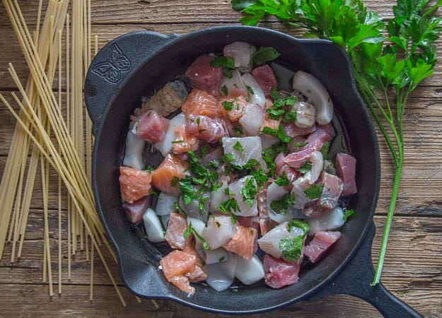 fresh seafood in a skillet before cooked