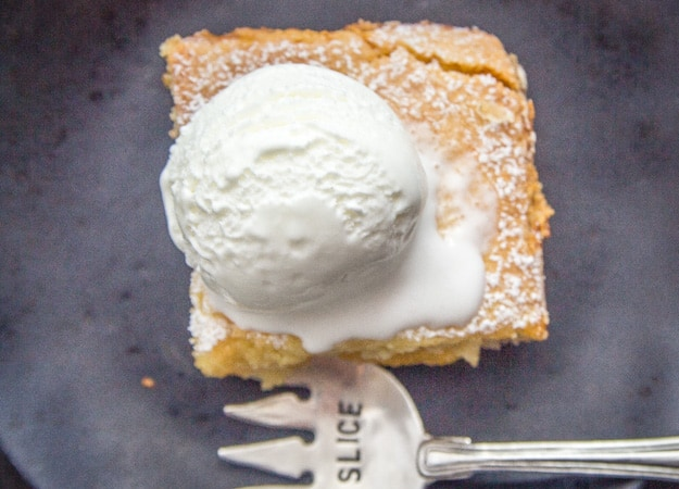 top view of peach filled Italian crostata bars on a plate with ice cream