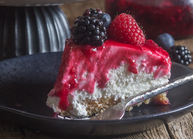 a slice of no bake cheesecake on a black plate