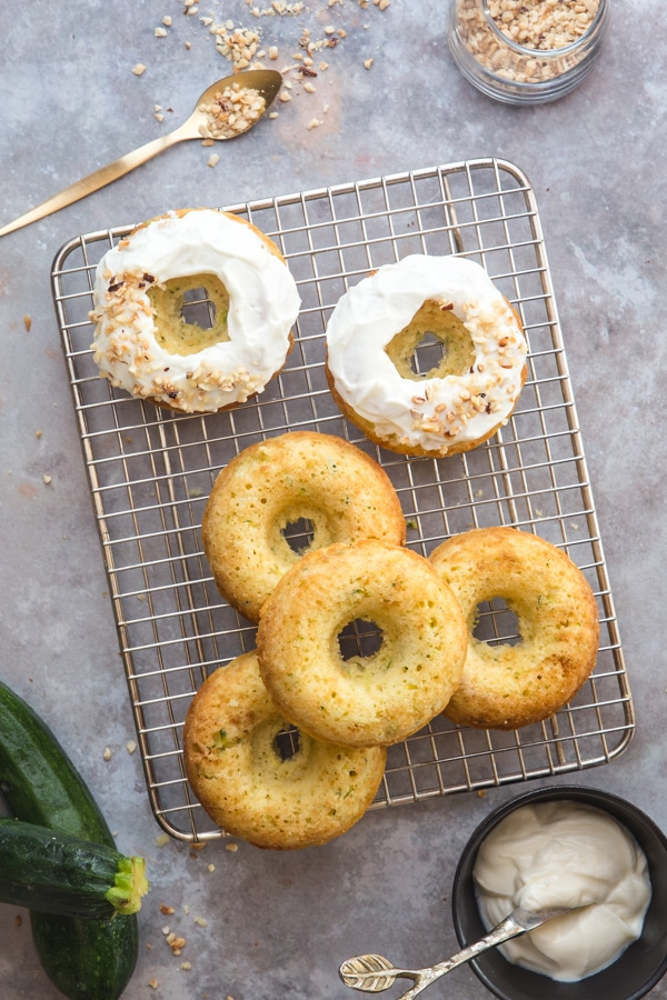 zucchini baked donuts 2 glazed and 4 plain on a wire rack
