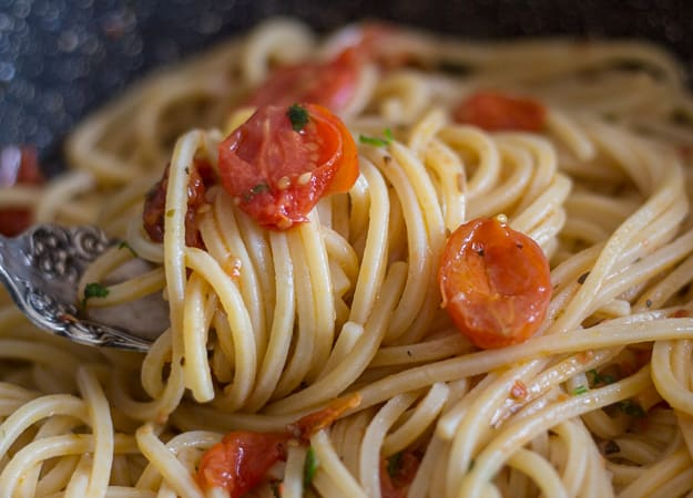spaghetti and anchovy on a fork