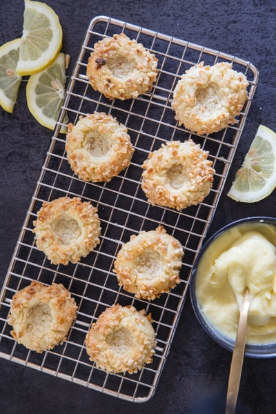 baked lemon thumbprint cookies on a wire rack