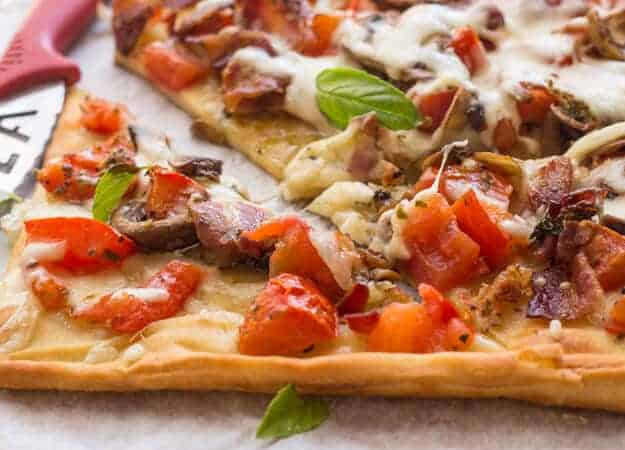 Cheesy Sautéed Mushroom Pancetta Pizza, the perfect ingredients to make the best Family night quick and easy Pizza. Italian at it's best.