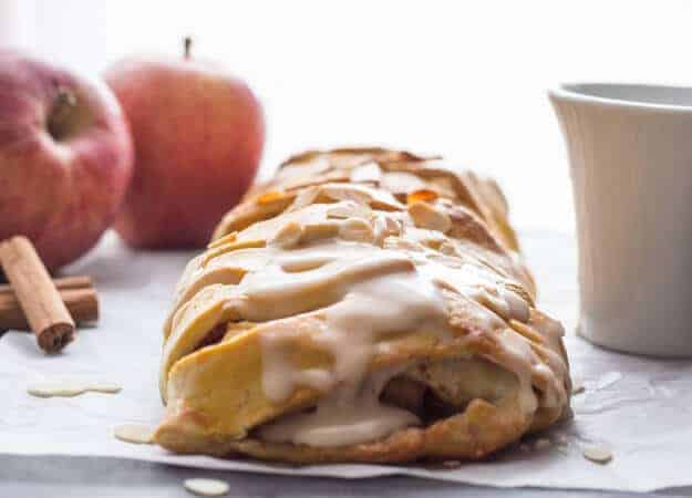homemade apple strudel with maple glaze on parchment paper