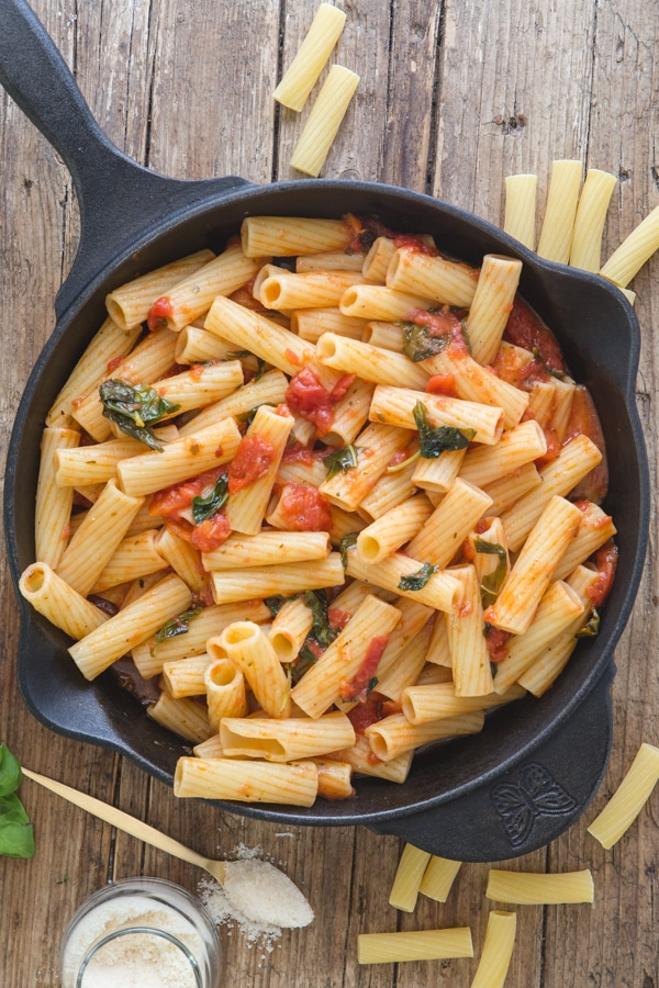 basil pasta sauce in a black pan