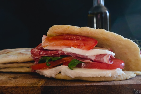 flat bread sandwich with cold meat mozzarella and tomatoes