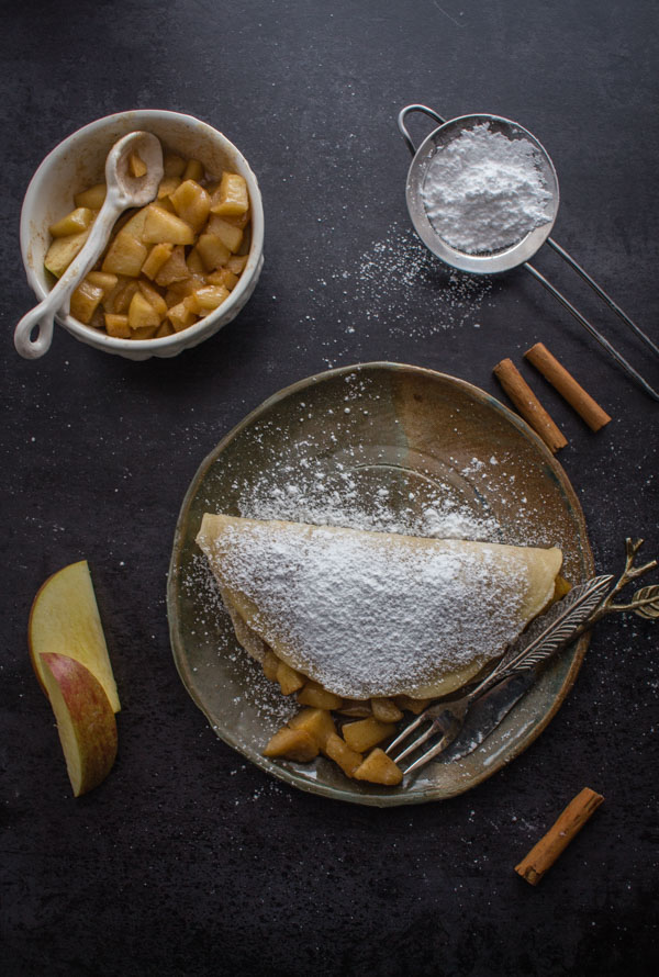 Homemade Apple Pie Cinnamon Crepes, a fast & easy crepe recipe with a delicious apple pie filling. The perfect snack or dessert.