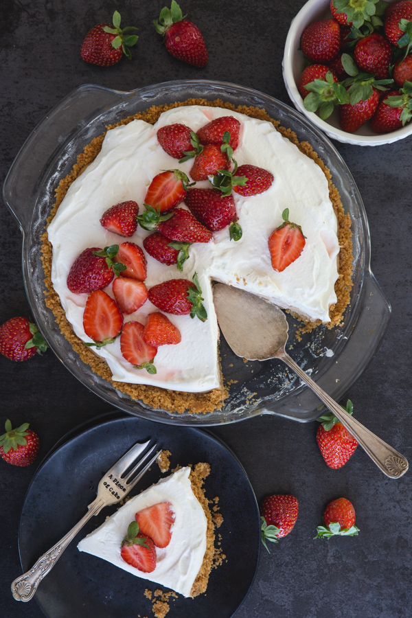 strawberry cheesecake a piece on a black plate