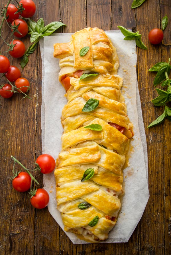 Easy Baked Caprese Strudel, an easy fresh vegetable summer appetizer or main dish, Italian recipe. Made with tomatoes, mozzarella & spices.