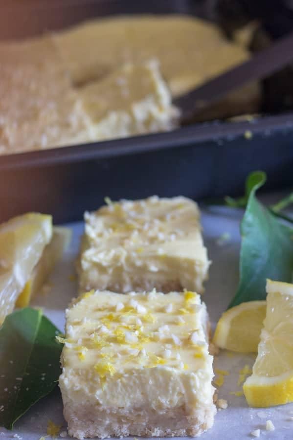 lemon cheesecake squares on a white board
