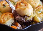 up close skillet hamburger pie on a spoon