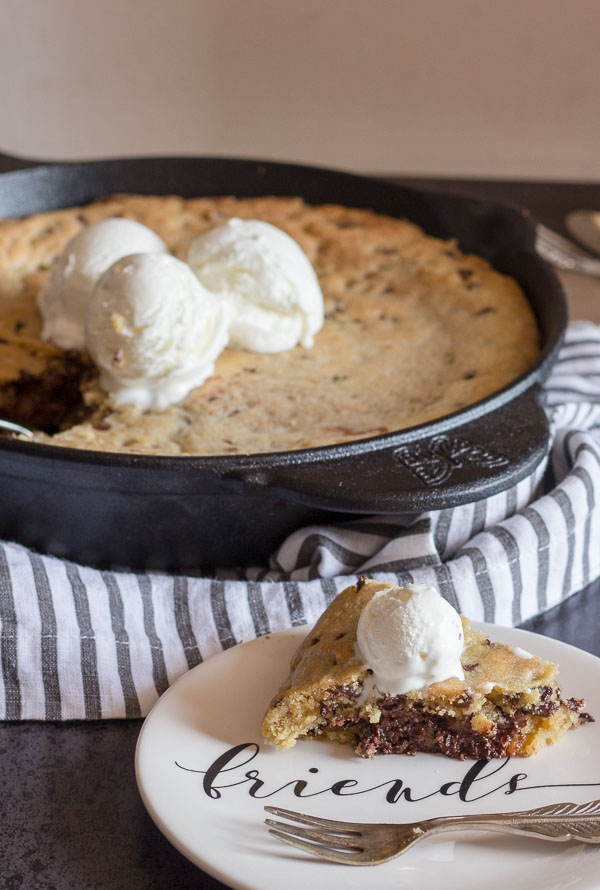 Double Chocolate Chip Skillet Cookie, an easy Cast Iron cookie recipe, stuffed with melted dark chocolate. Top with ice cream so delicious.