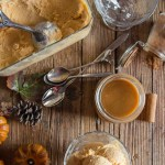 easy homemade pumpkin gelato on a wooden board, in a bowl, with cinnamon,