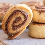 nutella pinwheel cookies one leaning on two stacked
