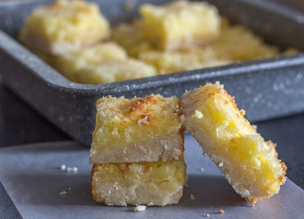 3 cut squares of pineapple coconut bars