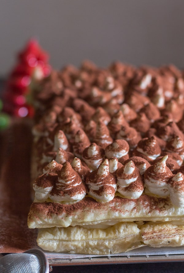 puff pastry tiramisu top view with sprinkled cocoa