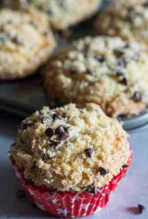 chocolate chip muffins in a muffin tin and one in front