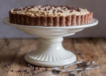 peanut butter pie on a white cake stand