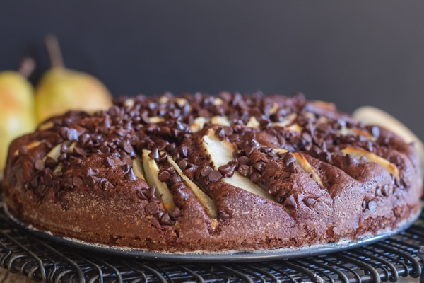 chocolate pear cake on a black wire rack