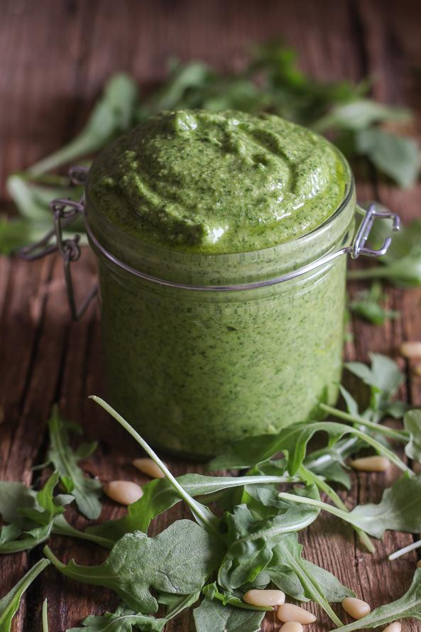 arugula pesto in a glass jar