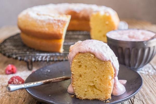 a slice of mascarpone cake with raspberry cream