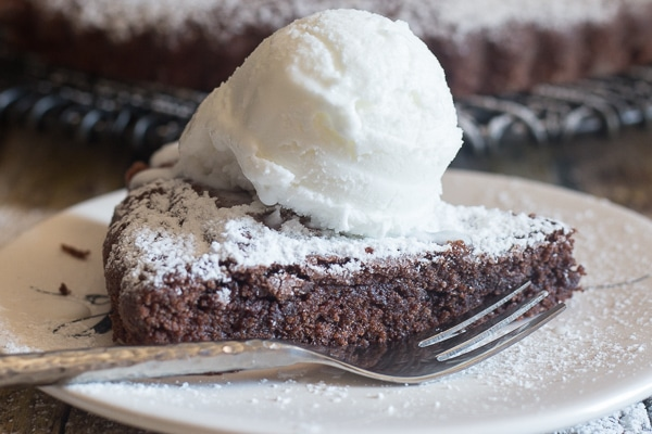 brownie cake slice up close on a white plate