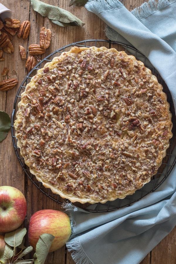 apple crostata on a black plate