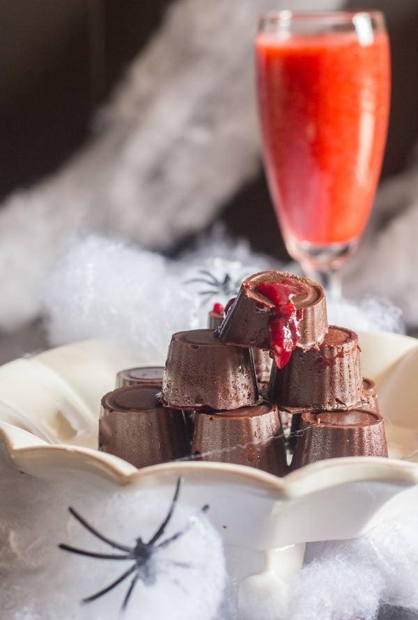 raspberry chocolates on a white plate