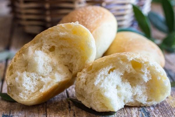 olive oil bread rolls cut in half