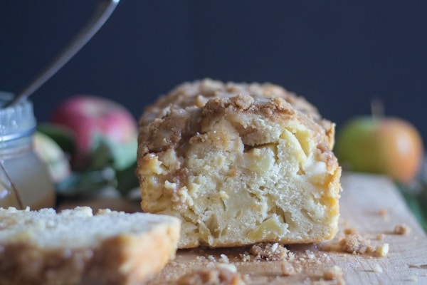 apple crumb bread with a slice cut