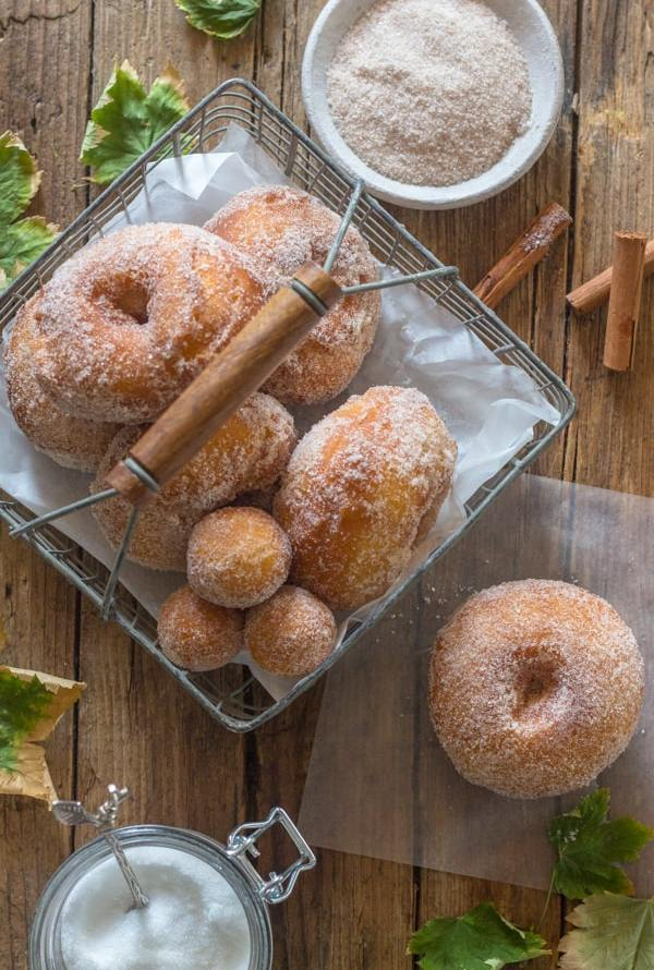 cake donuts in a basket and one on a board