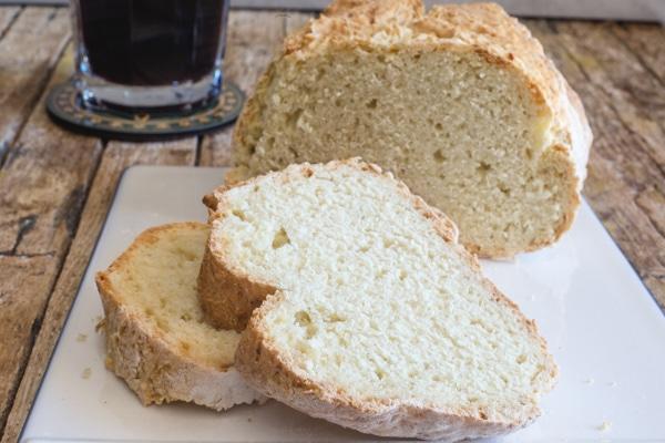 Irish soda bread and 2 slices on a white board