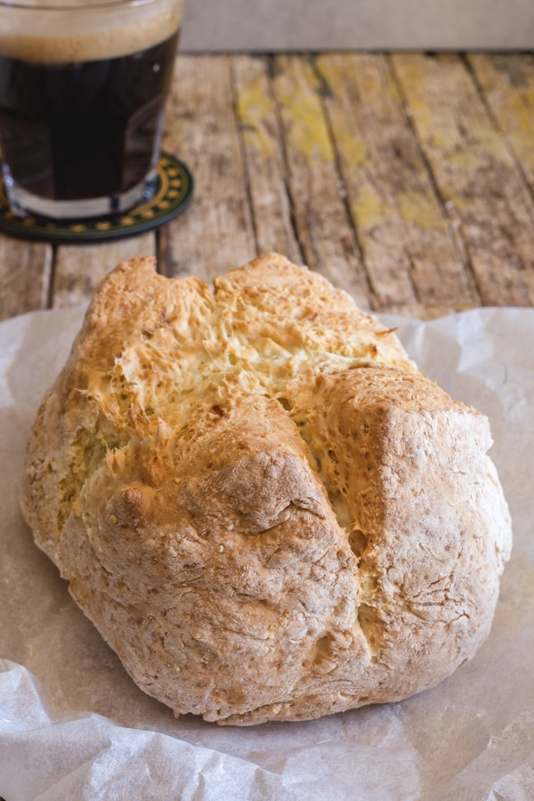 Irish soda bread baked on a white paper
