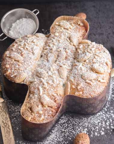 colomba baked with a slice cut on a black board