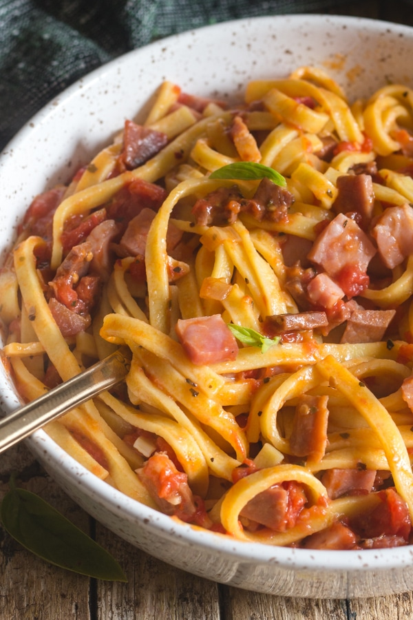 double pancetta pasta in a white bowl
