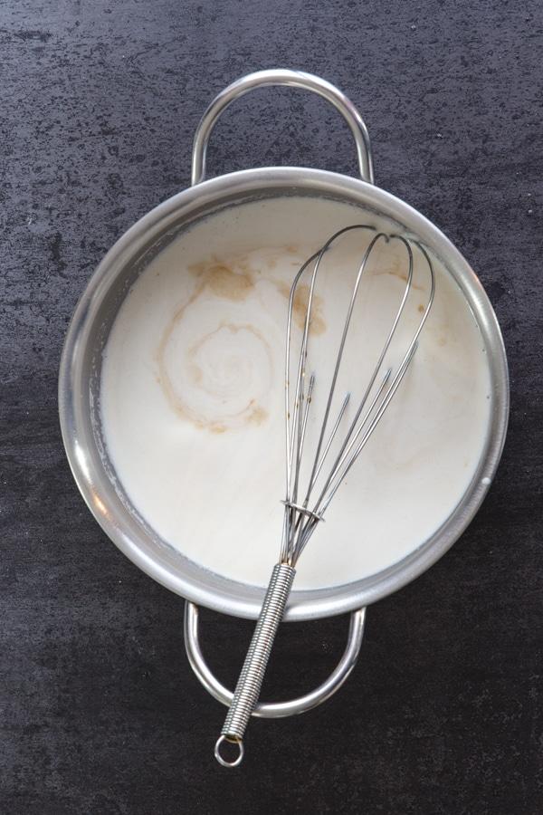 cream milk mixture in a pot