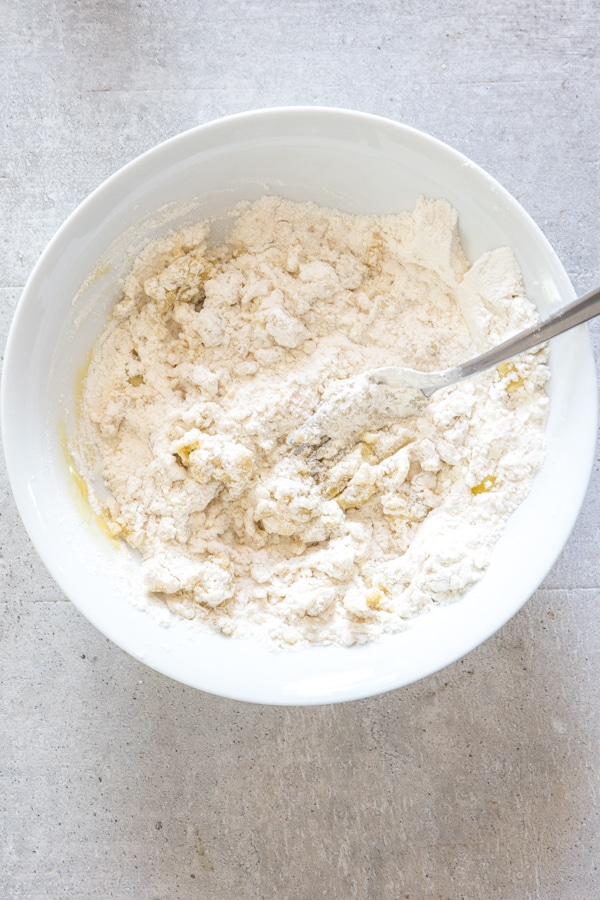 mixing the savory dough in a white bowl