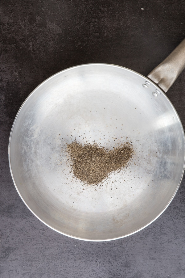 ground pepper in a silver pan