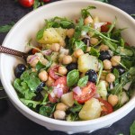 chickpea salad in a white bowl