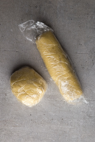 forming the dough into a ball and a log and wrapping in plastic