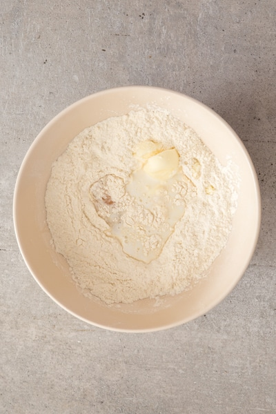 mixing the dry ingredients, butter and egg in a white bowl