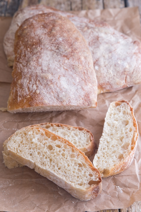 bread on parchment paper with 3 slices