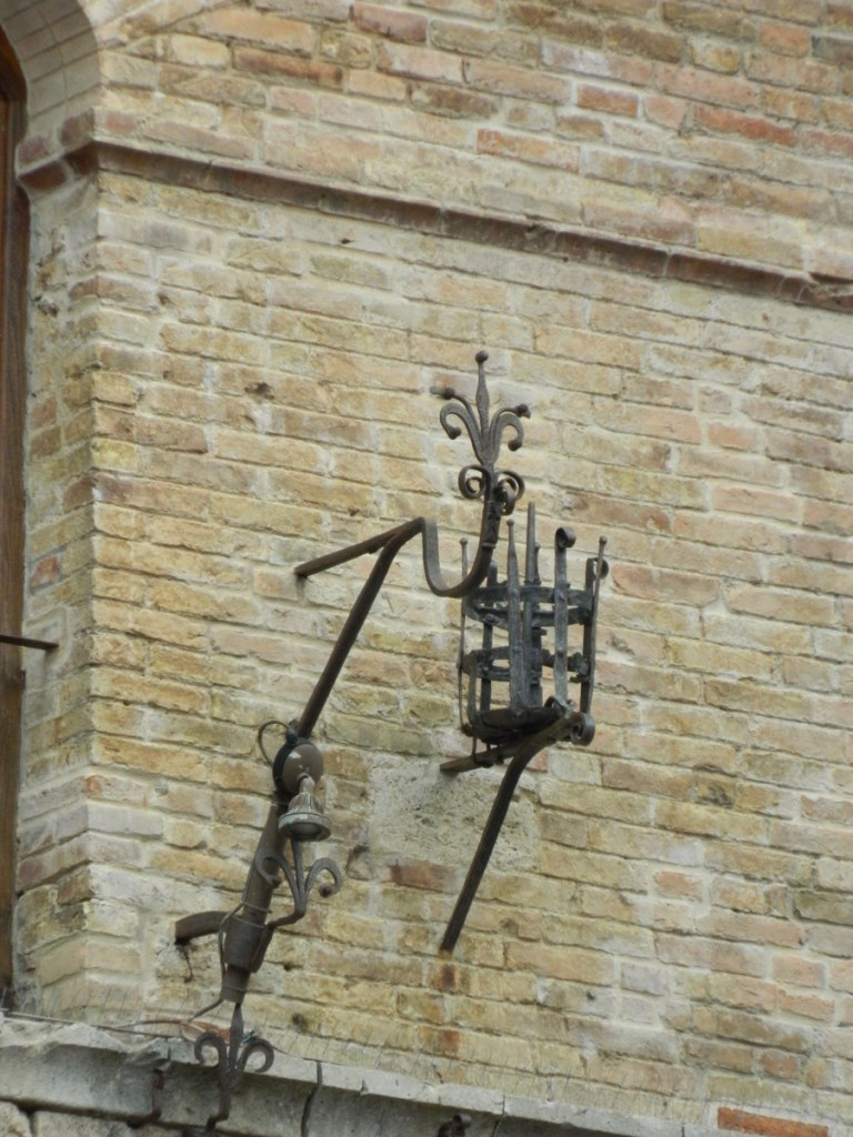 Decorative torch holder. San Gimignano, Tuscany.