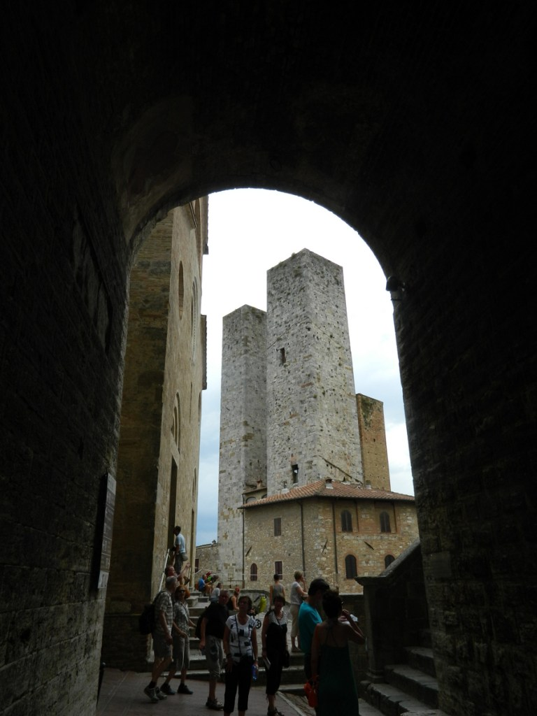 Towers seen from an arch near the Duomo, San Gimignano, Tuscany.