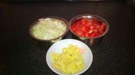 Onion, ginger, garlic and tomatoes- chopped, crushed and ready to cook!
