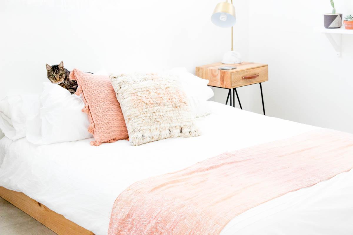 desert inspired bedroom blush tones with kitty