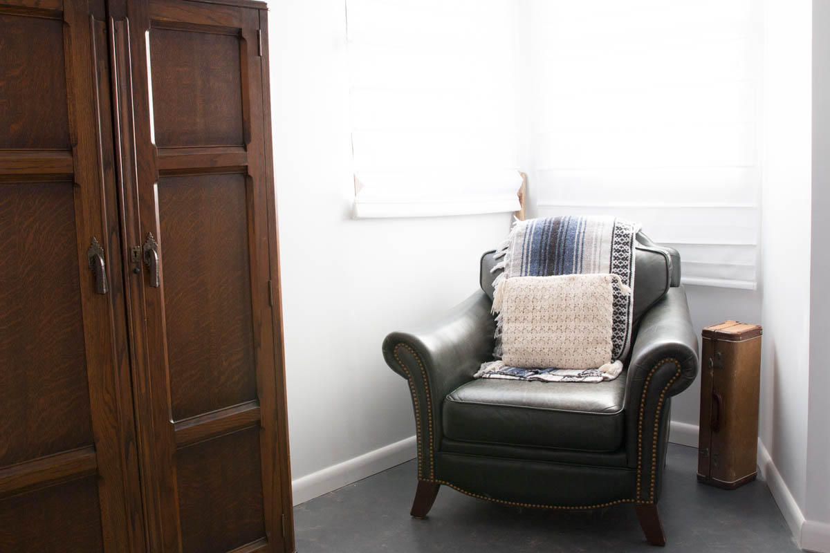 airbnb joshua tree moon cabin chair vintage wardrobe suitcase