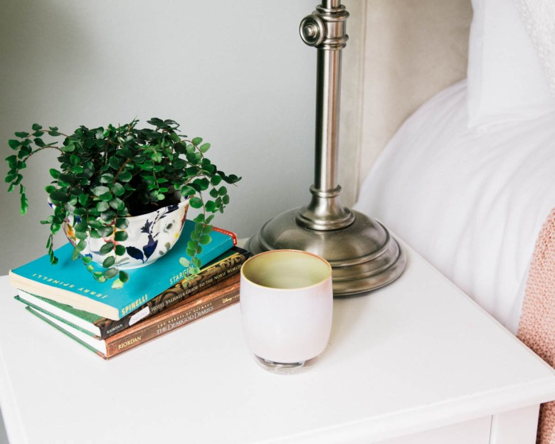 target bedside table, pottery barn lamp, glassy baby , anthropologie bowl